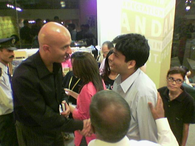 International Leadership Coach Robin Sharma congratulating Dhaval for his educational crusade