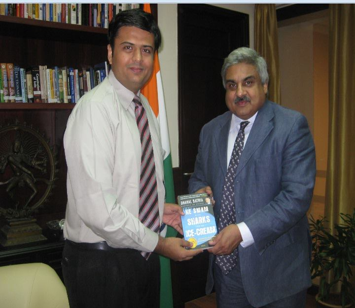 India's Ambassador to Oman Mr. Anil Wadhwa congratulates Dhaval for his outstanding books